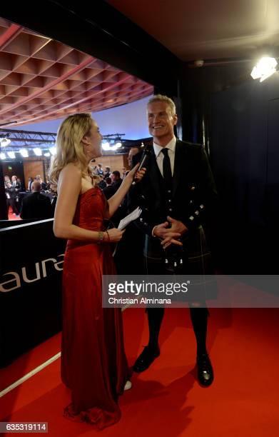 Laureus Ambassador David Coulthard speaks to Laureus Ambassador Kathi Woernd attends the 2017 Laureus World Sports Awards at the Salle des...