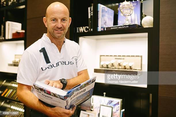 Laureus Ambassador Ian Walker pose during the Laureus IWC auction handover event at IWC store on November 20 2015 in Zurich Switzerland