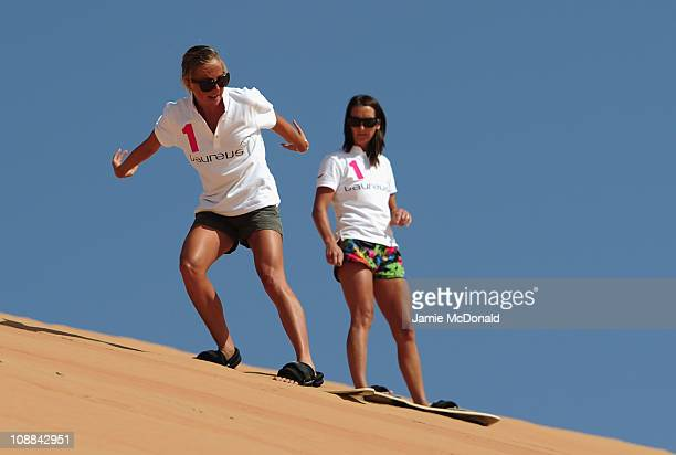 Laureus Ambassador Layne Beachley and Emma Snowsill during the Laureus Sandboarding Experience as part of the 2011 Laureus World Sports Awards in the...