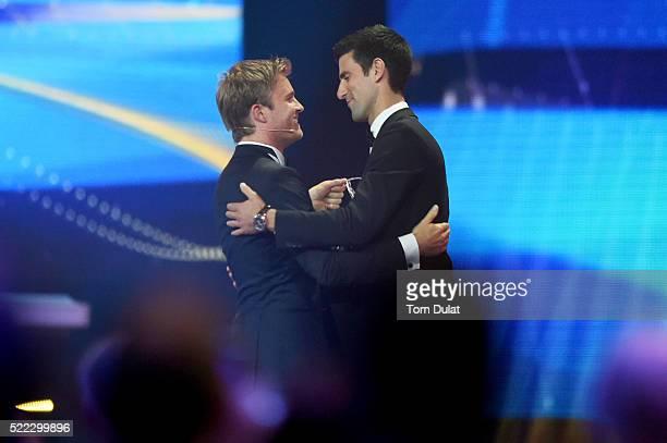 Laureus Ambassador Nico Rosberg congratulates the Laureus World Sportsmen of the Year Award winner Tennis player Novak Djokovic of Serbia during the...