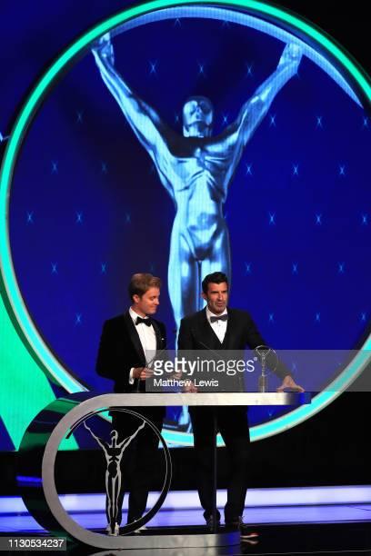 Laureus Ambassador Nico Rosberg with Laureus Academy Member Luis Figo announces the Laureus World Team Of the Year 2019 winner on stage during the...