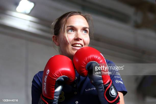 Laureus Ambassador Victoria Pendleton participates in a boxing session with a member of Carney's Community during the Victoria Pendelton Visit...