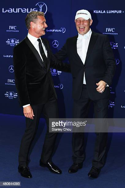 Laureus ambassadors Axel Schulz and David Coulthard attend the 2014 Laureus World Sports Awards at the Istana Budaya Theatre on March 26 2014 in...