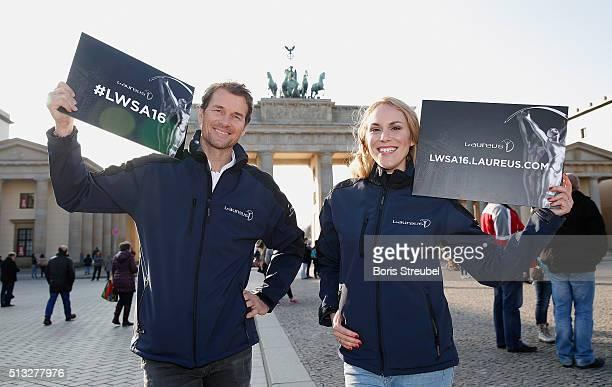 Laureus ambassadors Kathi Woerndl and Jens Lehmann pose with Laureus signature at Brandenburg Gate during the Berlin Nominations for the Laureus...