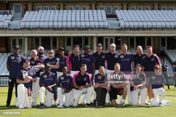 Laureus Ambassadors' Monty Panesar Devon Malcolm Matthew Hoggard Michael Vaughan Yohan Blake and Shane Warne pose with the Undercooked Team during...