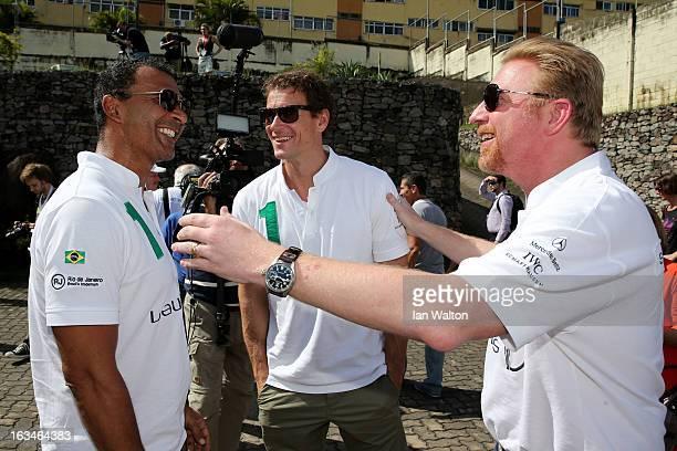 Laureus Ambassadors Ruud Gullit and Jens Lehmann with Laureus Academy Member Boris Becker attend the MercedesBenz Sprinter handover to the Bola...