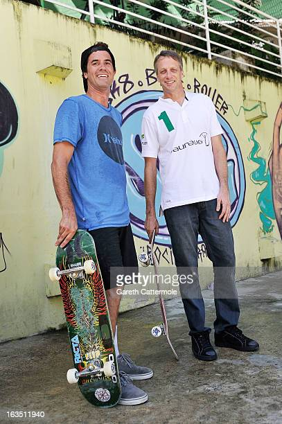 Laureus Award Winner Bob Burnquist and Laureus Academy Member Tony Hawk skateboard with local children at the Laureus visit to Rocinha during the...