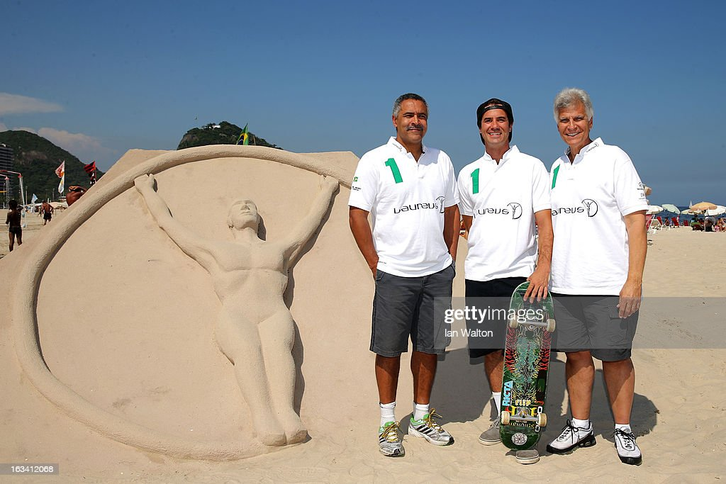 Laureus Award Winning skateboarder and Rio resident Bob Burnquist (C) welcomes Laureus Academy Members Daley Thompson (L) and Mark Spitz at the Laureus Welcome Photoshoot on Copacabana Beach on March 9,2013 in Rio de Janeiro, Brazil.