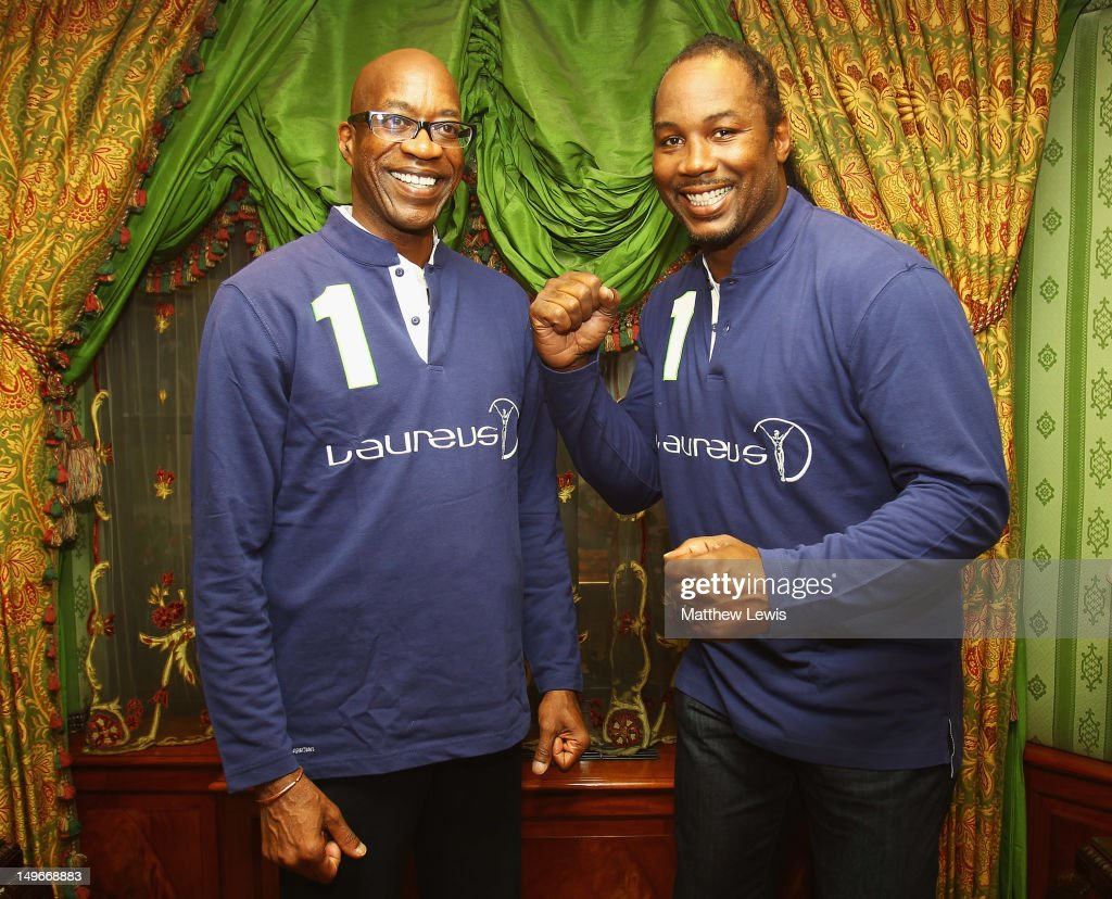 Laureus Chairman Edwin Moses unveils new Laureus Ambassador Lennox Lewis (R) pictured at MayFair House on August 1, 2012 in London, England.