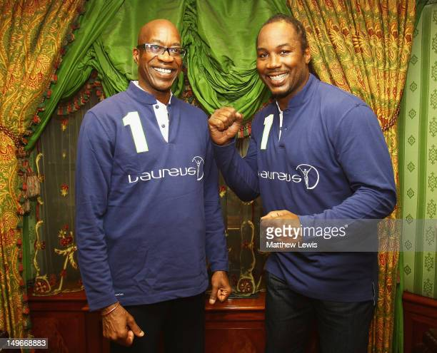 Laureus Chairman Edwin Moses unveils new Laureus Ambassador Lennox Lewis pictured at MayFair House on August 1 2012 in London England