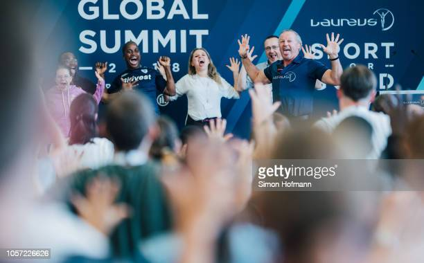 Laureus Chairman Sean Fitzpatrick performs a haka dance on stage during the Laureus Sport for Good Global Summit in partnership with Allianz at INSEP...