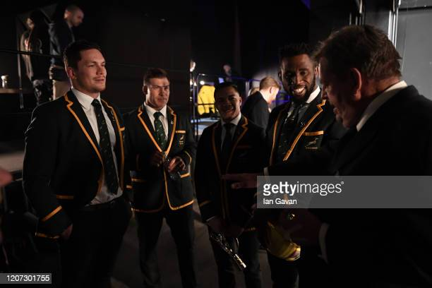 Laureus Executive Chairman Garrett Johann Rupert talks to members of Laureus World Team of the Year the South Africa Men's Rugby Team during the 2020...
