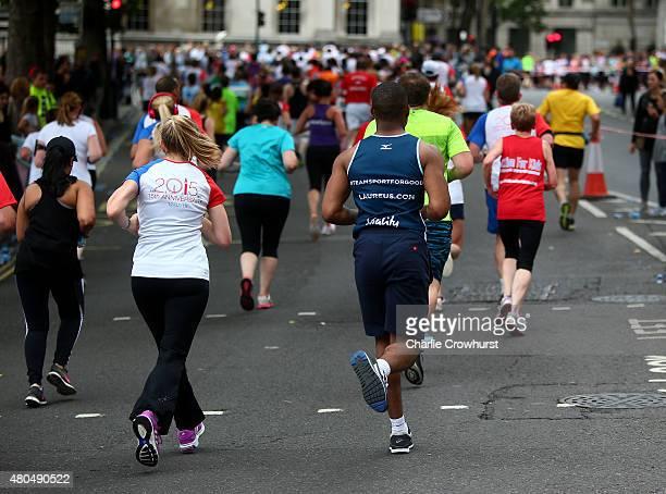 Laureus runners participate in Laureus British 10K run around central London during the Laureus British 10K on July 12 2015 in London England