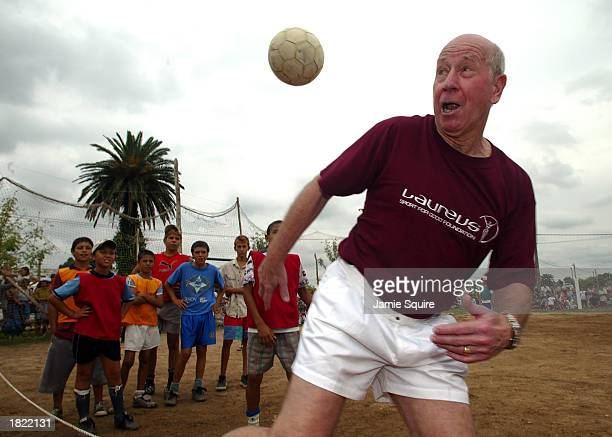 Laureus Sports Academy legend Bobby Charlton plays football with children from the Gonzalo Rodriguez Memorial Foundation project during the final day...