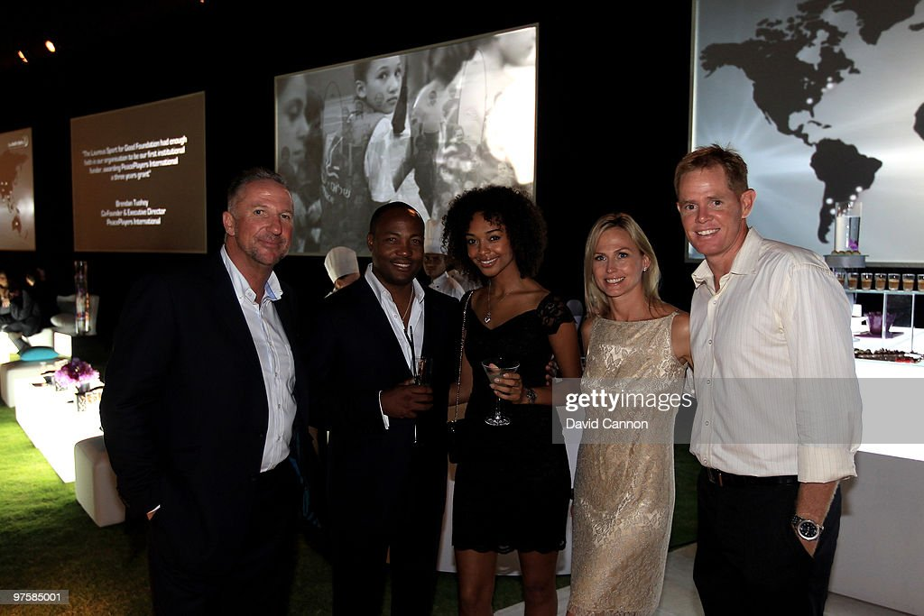 Laureus Sports Academy Sir Ian Botham with Brian Lara and guest with Patricia Lauderdale and her husband Shaun Pollock attends the Laureus Welcome Party part of the Laureus Sports Awards 2010 at the Fairmount Hotel on March 9, 2010 in Abu Dhabi, United Arab Emirates.