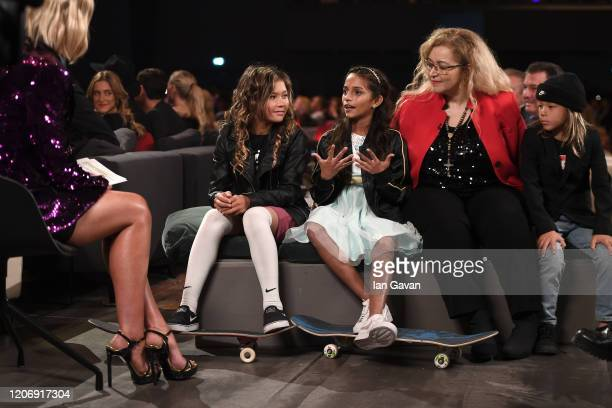 Laureus World Action Sportsperson of the Year nominee Rayssa Leal talks to co Host Amanda Davies as skateboarder Sky Brown listens during the 2020...
