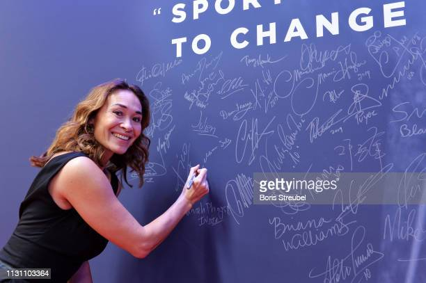 Laureus World Comeback Of The Year 2019 Nominee Bibian MentelSpee signs the Nelson Mandela wall during the 2018 Laureus World Sports Awards at Salle...