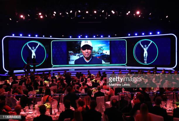 Laureus World Comeback Of The Year 2019 winner Tiger Woods accepts his award via video screen during the 2019 Laureus World Sports Awards on February...