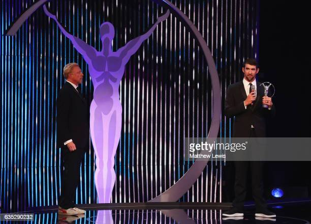 Laureus World Comeback of the Year winner Swimmer Michael Phelps of the US accepts his award from Laureus Academy member Boris Becker during the 2017...