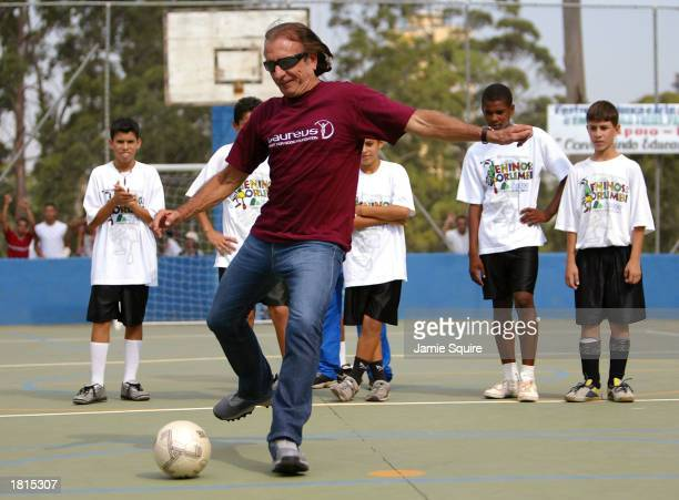 Laureus World Sports Academy legend Emerson Fittipaldi plays football with children from the Meninos Do Morumbi project during the first day of the...