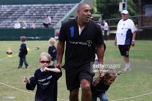Laureus World Sports Academy Member Daley Thompson is joined by Indigenous school children coaches and volunteers from key sports partners of the...