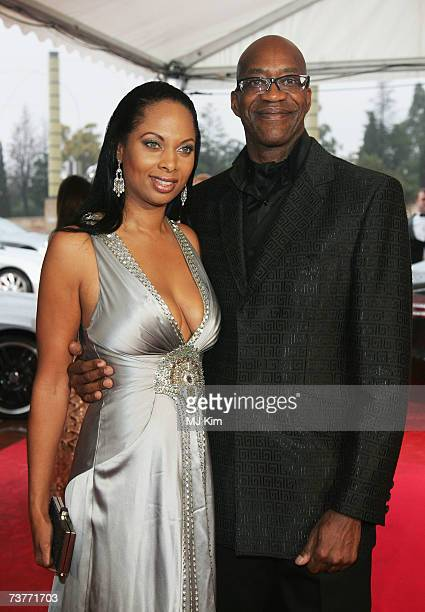 Laureus World Sports Academy member Edwin Moses and Michelle Douglas attend the awards ceremony during the Laureus Sports Awards at the Palau Sant...