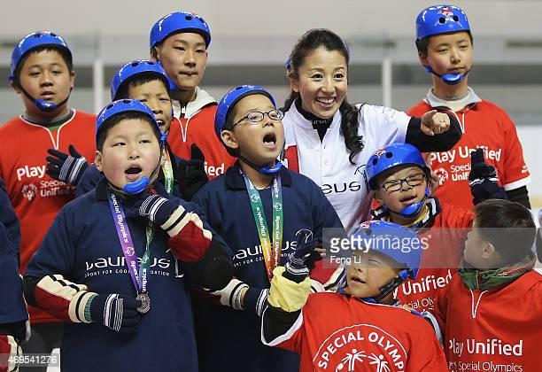 Laureus World Sports Academy member Yang Yang of China visits a Laureus Sport For Good Project prior to the Laureus World Sports Awards 2015 at the...
