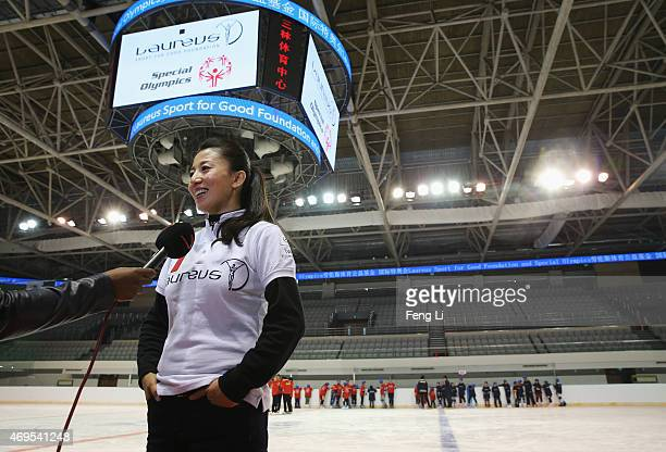 Laureus World Sports Academy member Yang Yang speaks to the media during a visit to a Laureus Sport For Good Project prior to the Laureus World...