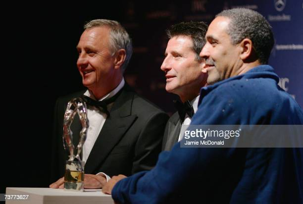 Laureus World Sports Academy members Johan Cruyff Lord Sebastian Coe and Daley Thompson pose with an award as he attends the Laureus Sports Awards at...