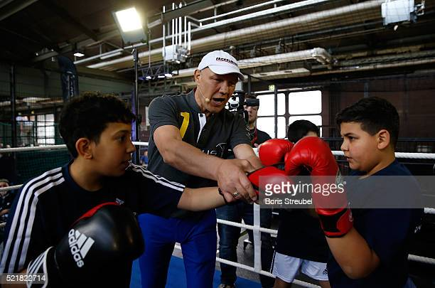 Laureus World Sports Ambassador Axel Schulz offers advise to local children during the Laureus Sport for Good Jam at The Base on April 17 2016 in...