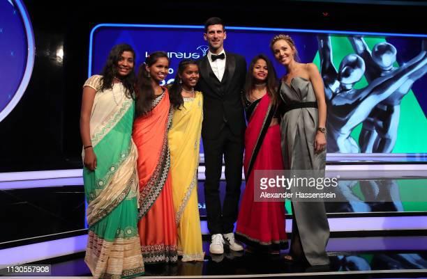 Laureus World Sportsman of The Year 2019 winner Novak Djokovic and Elena Djokovic with Neeta Kumari Hema Kumari Konika Kumari Radha Kumari of the...