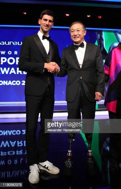 Laureus World Sportsman of The Year 2019 winner Novak Djokovic greets Xia Boyua double amputee who climbed Everest winner of the Laureus Sporting...