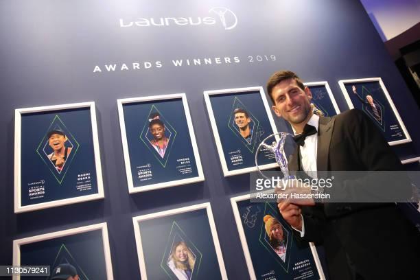 Laureus World Sportsman of The Year 2019 winner Novak Djokovic signs the wall during the 2019 Laureus World Sports Awards on February 18 2019 in...