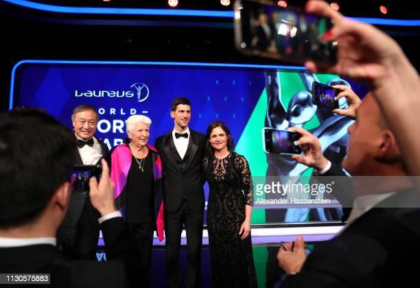 Laureus World Sportsman of The Year 2019 winner Novak Djokovic with Laureus Academy Members Dawn Fraser and Lorena Ochoa on stage after the 2019...