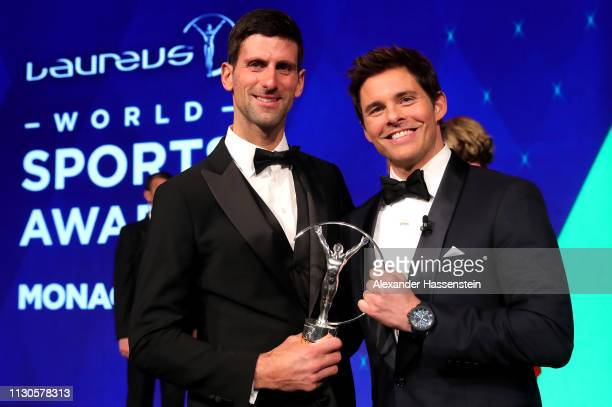 Laureus World Sportsman of The Year 2019 winner Novak Djokovic with host James Marsden during the 2019 Laureus World Sports Awards on February 18...