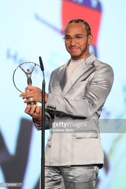 Laureus World Sportsman of the Year British F1 driver Lewis Hamilton poses with his award during the 2020 Laureus World Sports Awards at Verti Music...