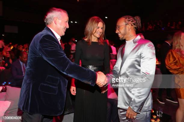Laureus World Sportsman of the Year nominee Lewis Hamilton greets Laureus Academy member Sean Fitzpatrick and his wife Bronwyn Fitzpatrick ahead of...