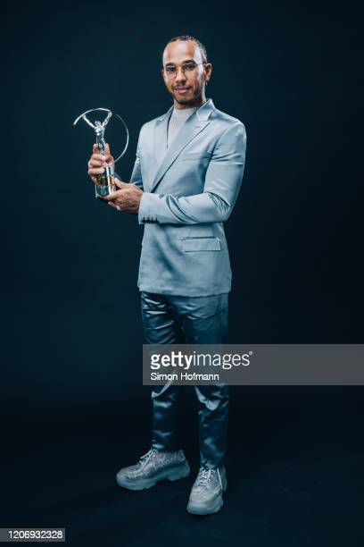Laureus World Sportsman of the Year winner Lewis Hamilton poses with his award during the 2020 Laureus World Sports Awards on February 17 2020 in...