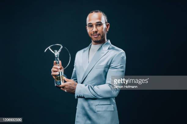 Laureus World Sportsman of the Year winner Lewis Hamilton poses with his award during the 2020 Laureus World Sports Awards on February 17, 2020 in...