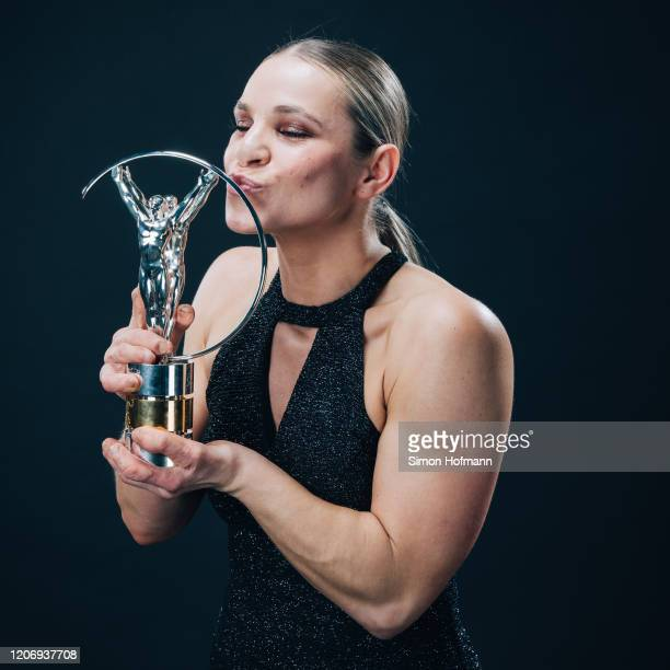 Laureus World Sportsperson of the Year with a Disability winner Oksana Masters poses with the trophy at the Verti Hall during the 2020 Laureus World...