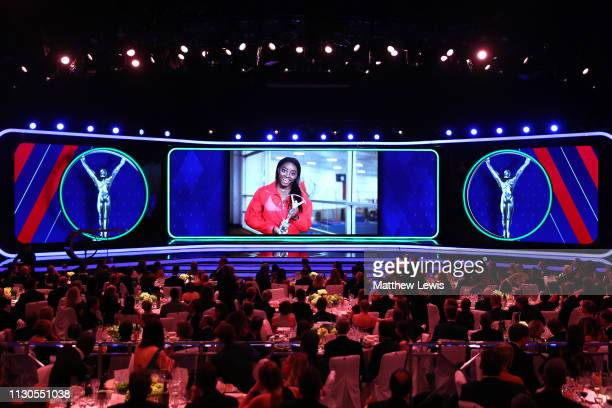 Laureus World Sportswoman of The Year 2019 Simone Biles accepts her award via video screen during the 2019 Laureus World Sports Awards on February 18...