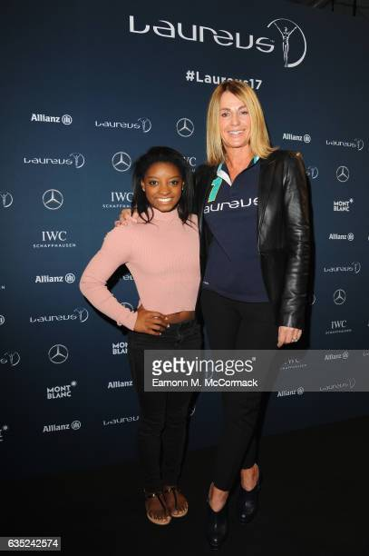 Laureus World Sportswoman of the Year nominee and Gymnast Simone Biles of the US and Laureus Academy member Nadia Comaneci pose at a media interview...