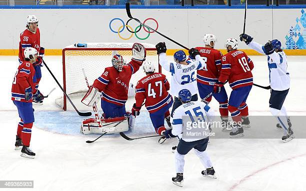 Lauri Korpikoski of Finland celebrates after scoring a goal against Lars Haugen of Norway in the first period during the Men's Ice Hockey Preliminary...