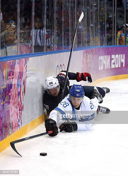 Lauri Korpikoski of Finland goes for the puck against Ryan Suter of the United States in the third period during the Men's Ice Hockey Bronze Medal...