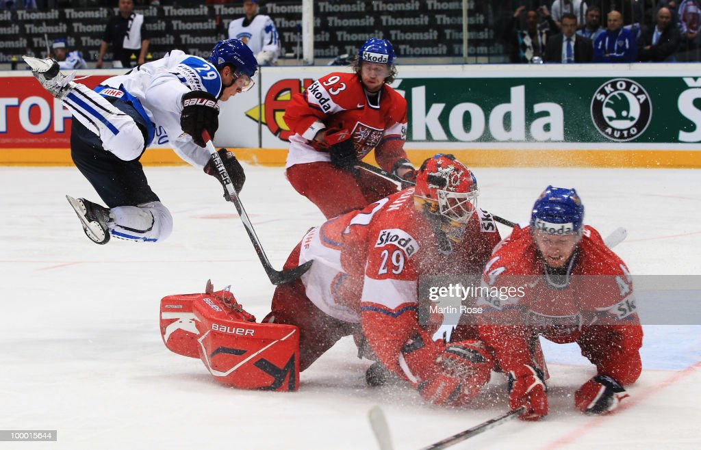 Lauri Korpikoski #29 of Finland jumps over goaltender Tomas Vokoun #29 of Czech Republic during the IIHF World Championship quarter final match between Finland and Czech Republic at Lanxess Arena on May 20, 2010 in Cologne, Germany.