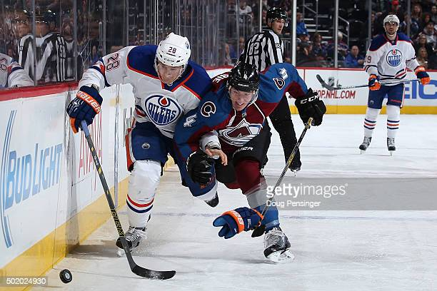 Lauri Korpikoski of the Edmonton Oilers and Tyson Barrie of the Colorado Avalanche pursue the puck at Pepsi Center on December 19, 2015 in Denver,...