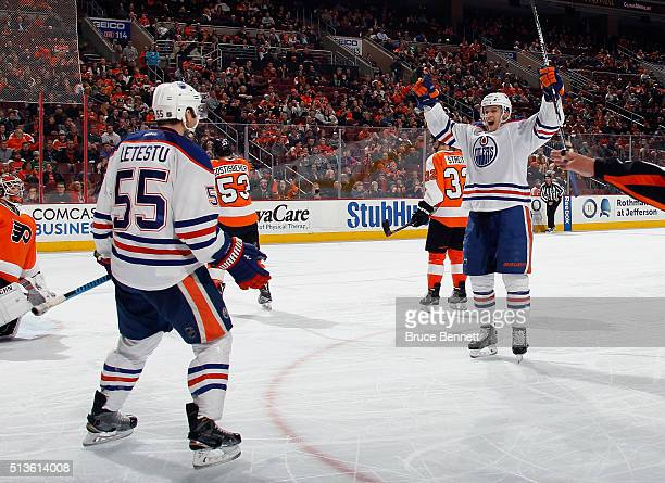Lauri Korpikoski of the Edmonton Oilers celebrates his shorthanded goal at 1159 of the third period against the Philadelphia Flyers and is joined by...