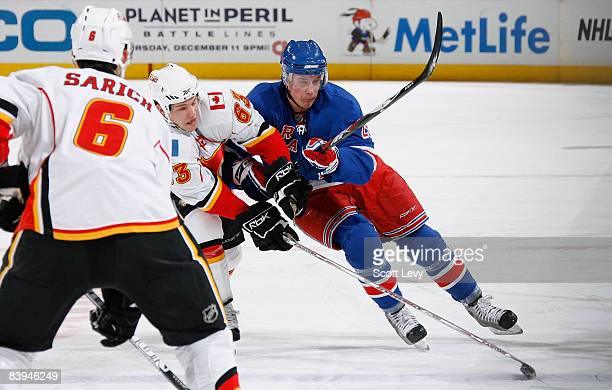 Lauri Korpikoski of the New York Rangers defends against Warren Peters of the Calgary Flames during the first period on December 7 2008 at Madison...