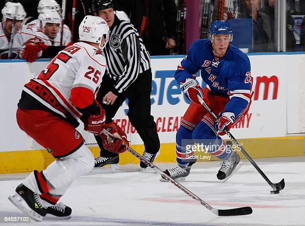 Lauri Korpikoski of the New York Rangers handles the puck against Joni Pitkanen of the Carolina Hurricanes on January 27 2009 at Madison Square...