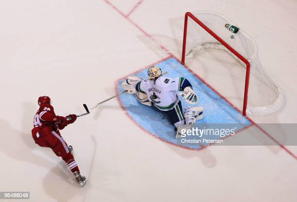 Lauri Korpikoski of the Phoenix Coyotes scores a shootout goal past goaltender Roberto Luongo of the Vancouver Canucks during the NHL game at...